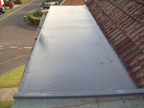 how to build a flat roof dormer window